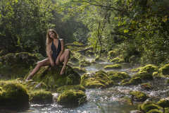 Royalty Free Image - A woman beside the forest river