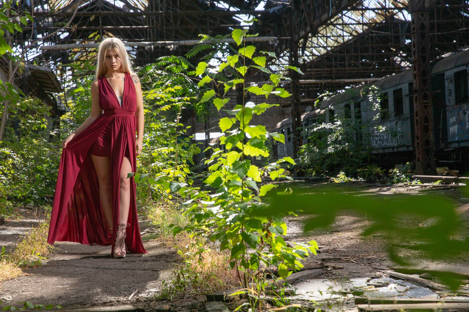 Royalty Free Image - Beautiful woman in red dress on an abandoned train station.